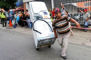 Aubaine à Caracas (photo : REUTERS / Carlos Garcia Rawlins)
